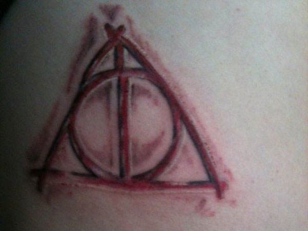Red Ink Hallows Tattoo Design Idea