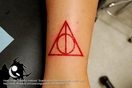 Red Ink Nice And Amazing Deathly Hallows Tattoo