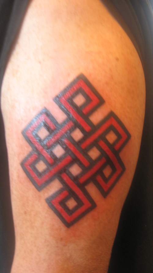 Red Ink Nice And Awesome Endless Knot Tattoo Design Idea