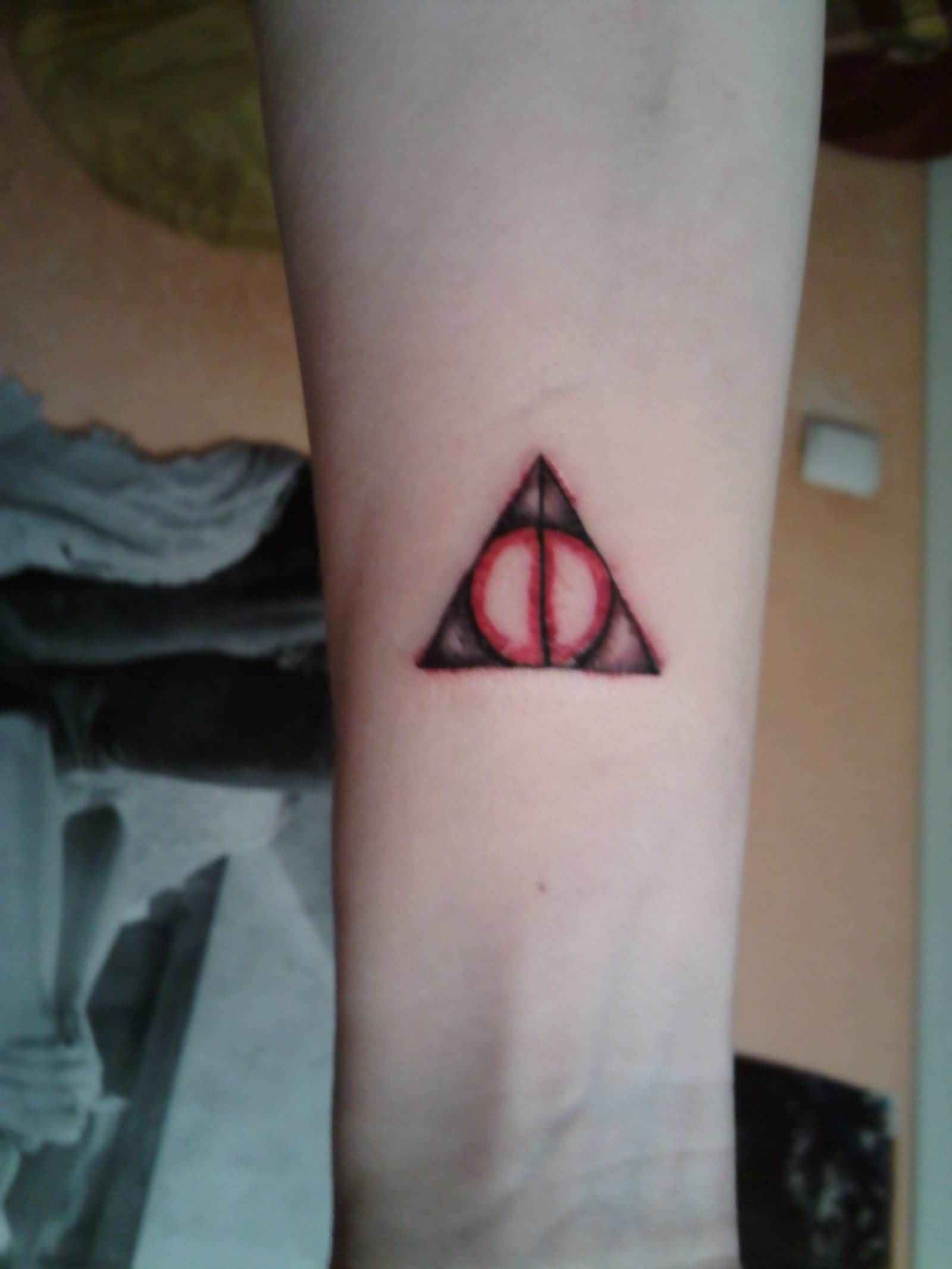 Red Ink Nice Hallows Tattoo