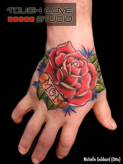 Red Rose Flower With Nice Mom Banner Tattoo On Hand
