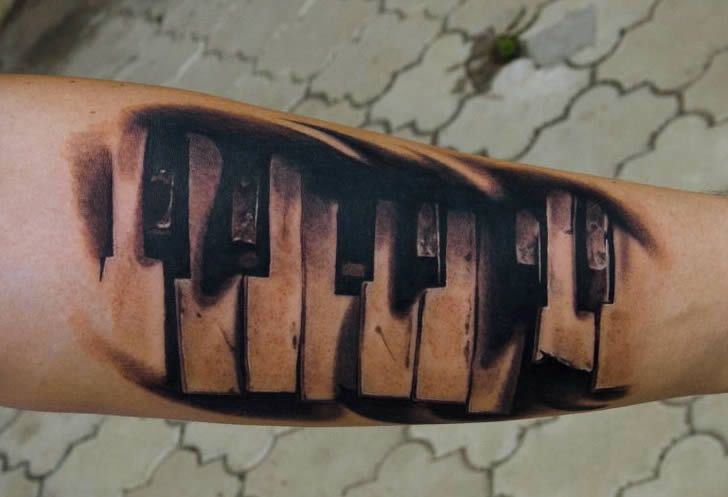 Ripped Skin 3D Piano Keys Tattoo Design Idea On Forearm