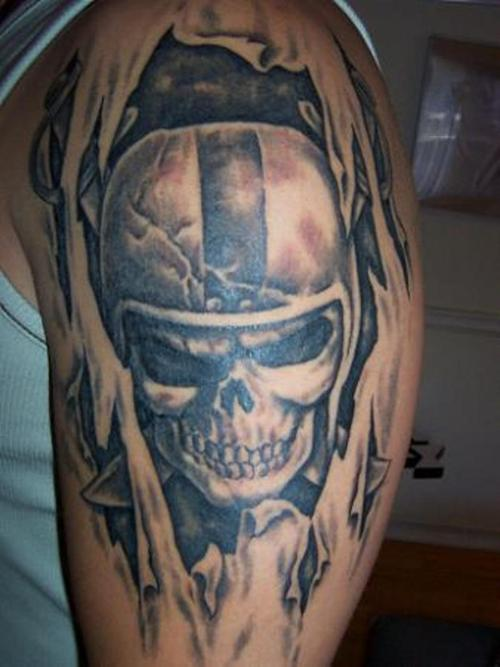 Ripped Skin Awesome And Nice Oakland Raiders Skull Tattoo For Men