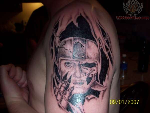 Ripped Skin Awesome Oakland Raiders Tattoo On Shoulder