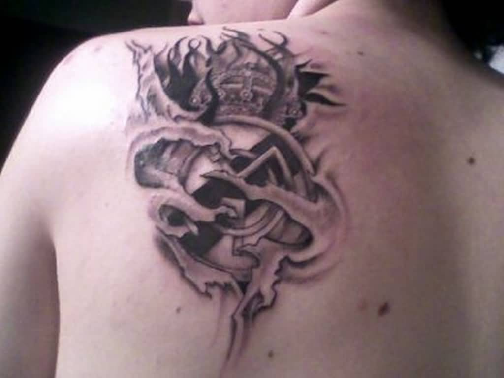 Ripped Skin Awesome Real Madrid Tattoo Design On Upper Back
