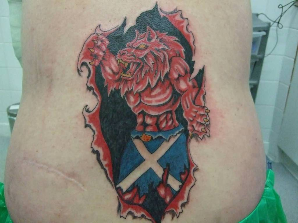 Ripped Skin Dangerous Scottish Lion With Flag Tattoo On Rib Side