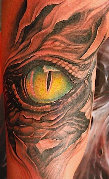 Ripped Skin Outstanding And Classy Cool Reptile Snake Eye Tattoo