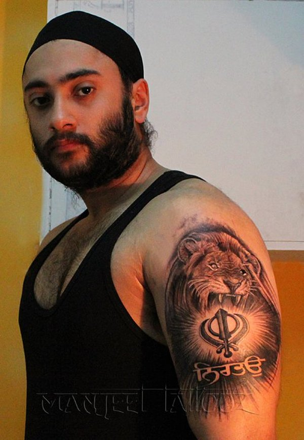 Roaring Lion With Khanda And Punjabi Font Tattoo On Shoulder