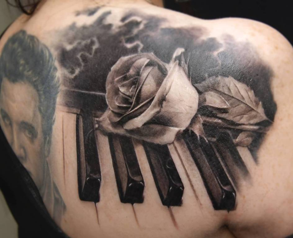 Rose With Tremendous Piano Keys Tattoo Design Idea On Upper Back