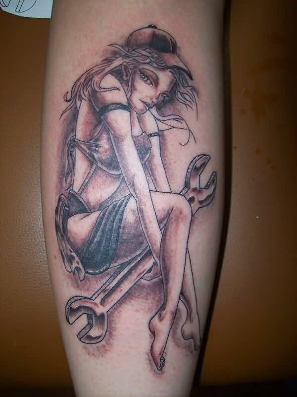 Sad Mechanic Pin Up Girl Hold Tool Tattoo
