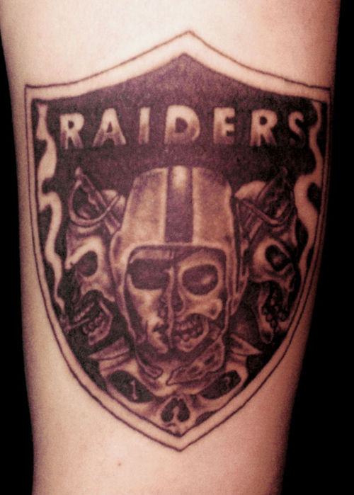 Scary Skull With Smoke Oakland Raiders Logo Tattoo