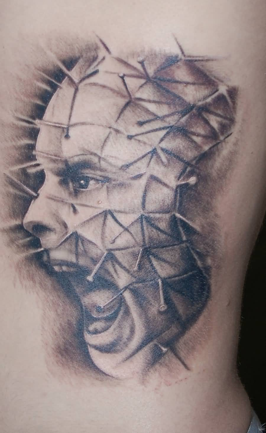 Shouting Pinhead Face Tattoo Design On Side