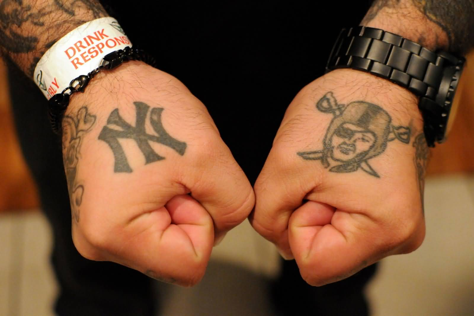 Side Hand Oakland Raiders With Symbol Tattoo