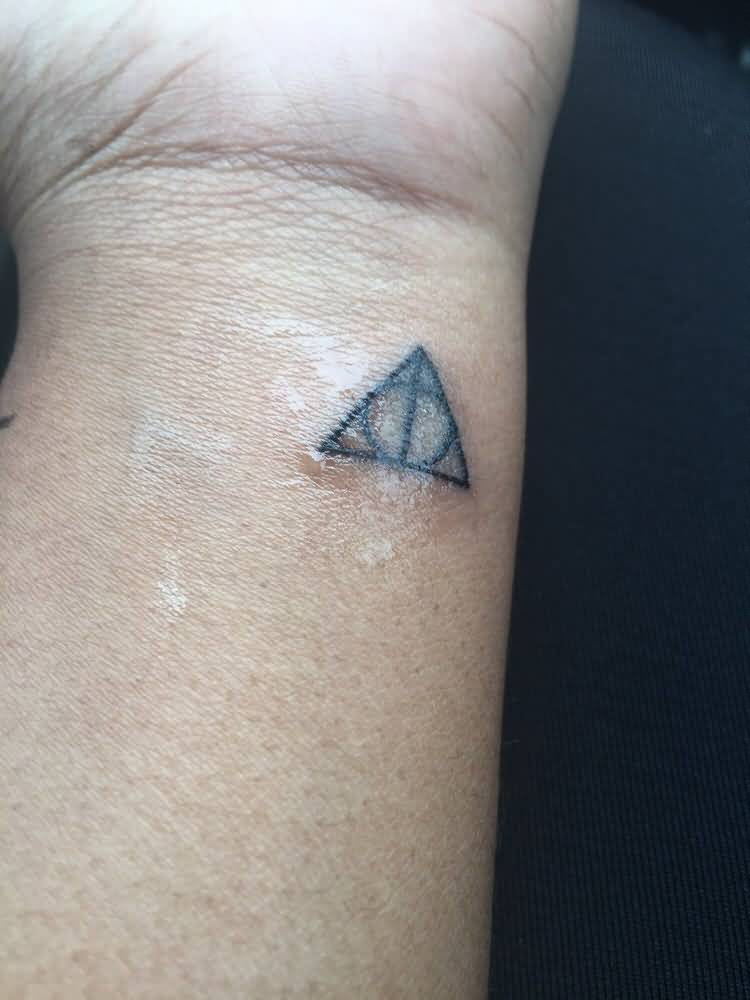 Simple And Nice Hallows Tattoo On Side Wrist