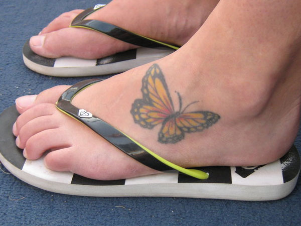 Simple And Nice Monarch Butterfly Tattoo On Girl Foot