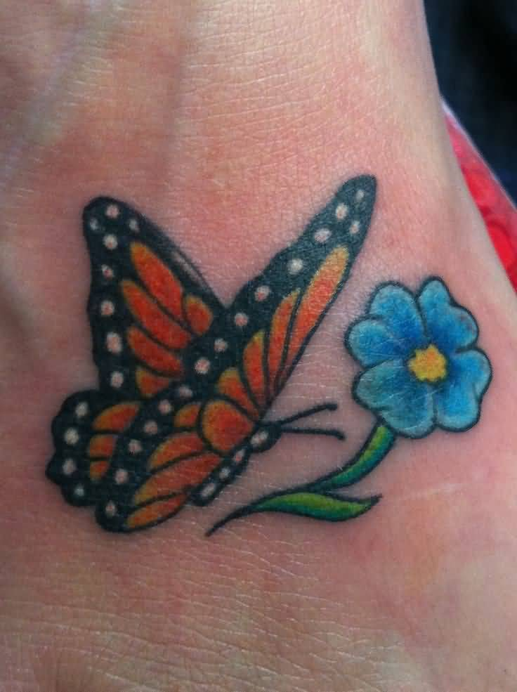 Simple And Nice Monarch Butterfly With Lovely Flower Tattoo