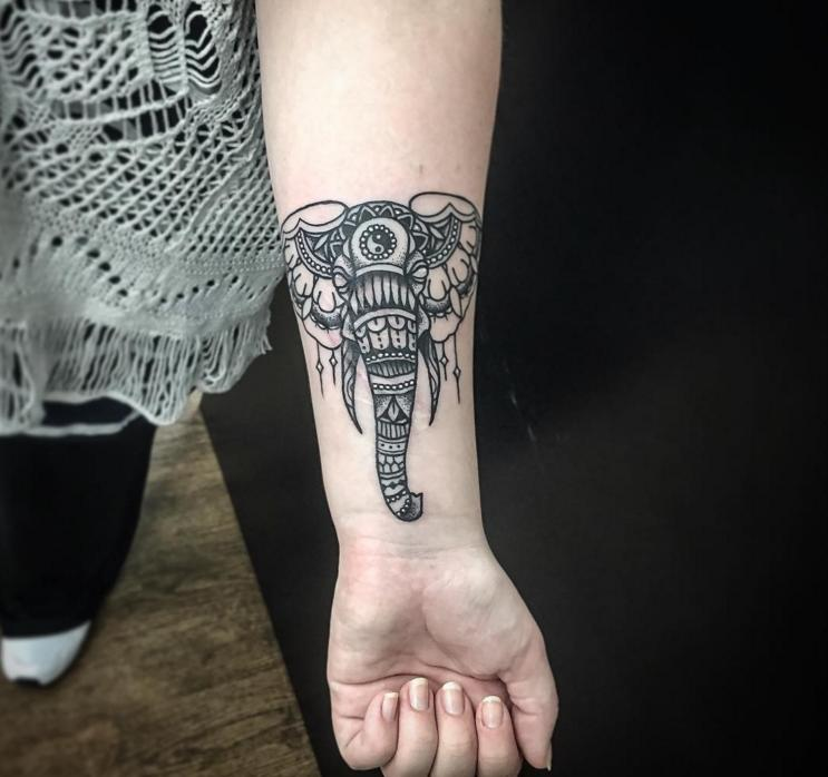 Simple And Nice Mosaic Face Of Elephant Wrist Tattoo