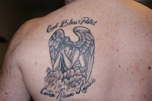 Simple And Nice Praying Angel With Nice God Bless Prayer Tattoo