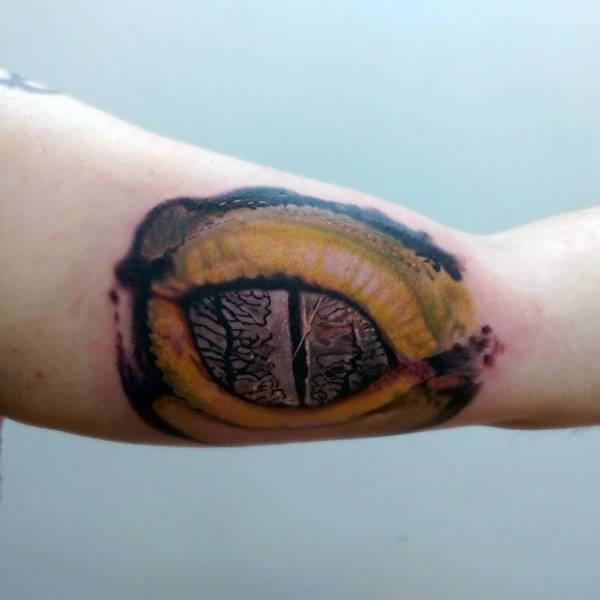 Simple Bicep Reptile Eye Tattoo