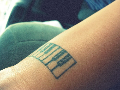 Simple Black Ink Piano Keys Tattoo On Wrist
