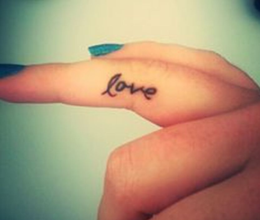 Simple Love Text Tattoo On Girl Finger