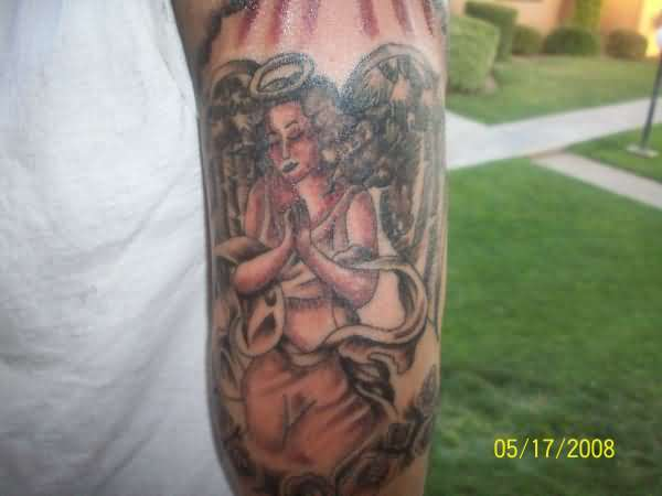 Simple Praying Angel Tattoo On Tricep