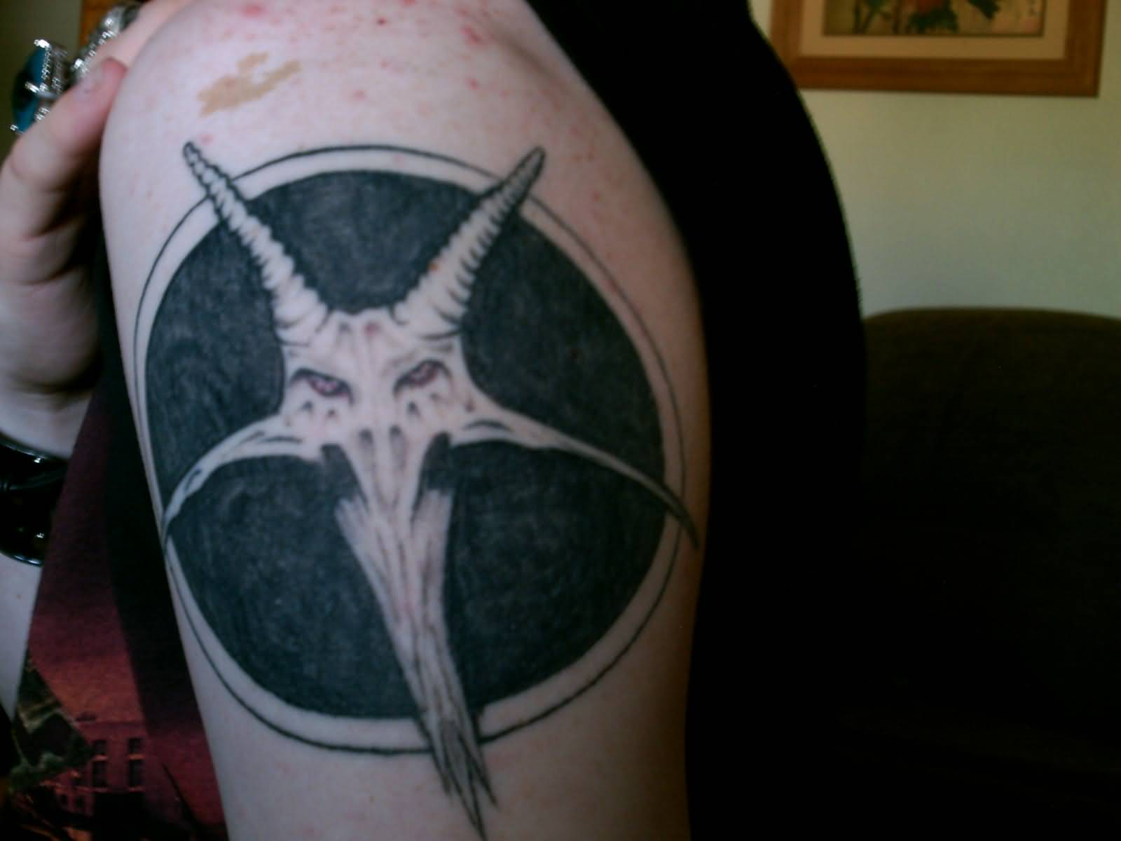 Simple Satan Face In Black Circle Tattoo Make On Shoulder