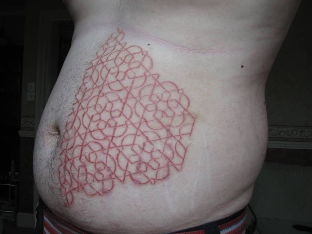 Simple Scarification Pattern Tattoo On Stomach Side