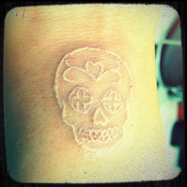 Simple Scarification Skull Tattoo Idea