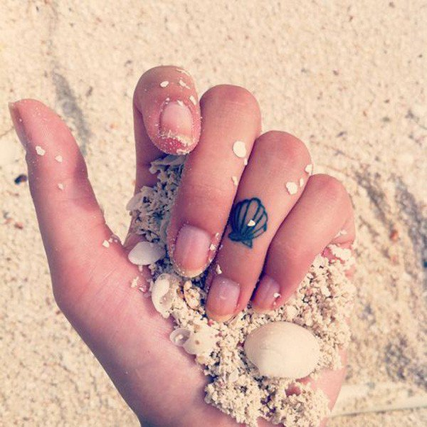 Simple Sea Creature Seashell Tattoo On Girl Finger