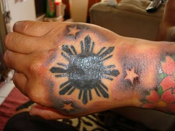Simple Star And Nice Dark Shaded Filipino Sun Tattoo On Hand