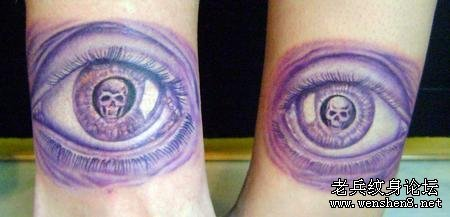Skull In Purple Escher Eye Tattoo