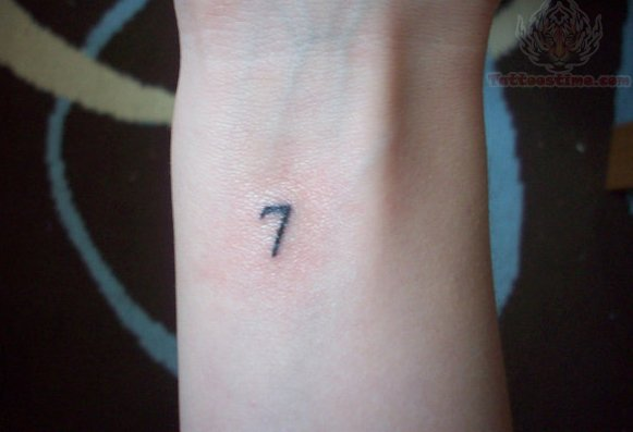 Small And Nice Seven Number Tattoo On Wrist