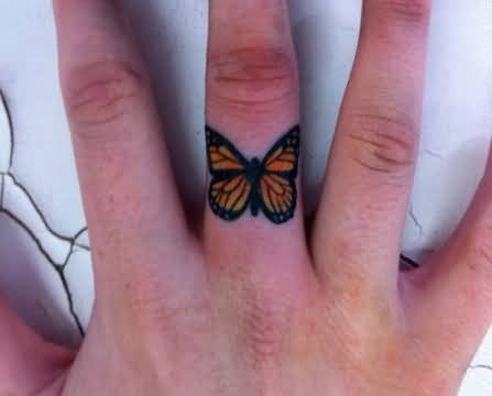 Small And Simple Monarch Butterfly Tattoo On Finger