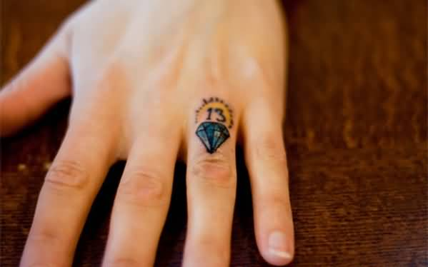 Small Diamond With Small Thirteen Number Tattoo On Finger