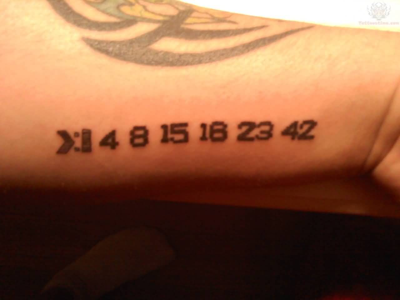 Small Digits Black Ink Numbers With Tribal Tattoo On Wrist