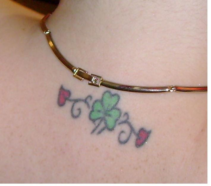 Small Simple Shamrock Leafs Heart Tattoo On Nape