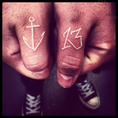 Small White Ink Anchor And Nice Thirteen Number Tattoo On Both Thumbs