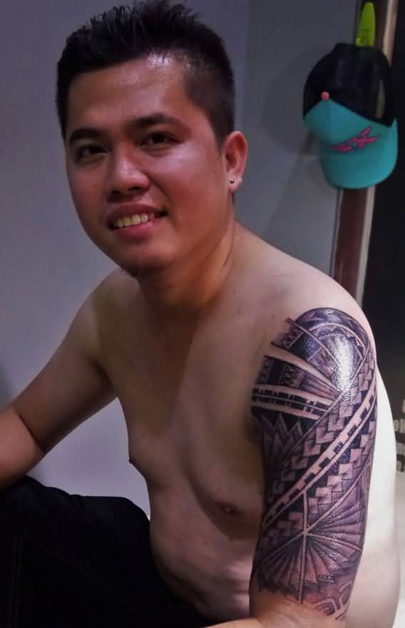 Smiling Men Show Nice Filipino Tribal Hawaiian Pattern Tattoo
