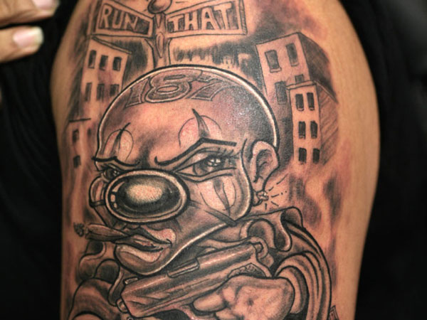 Smoking Clown Gangsta Tattoo On Half Sleeve