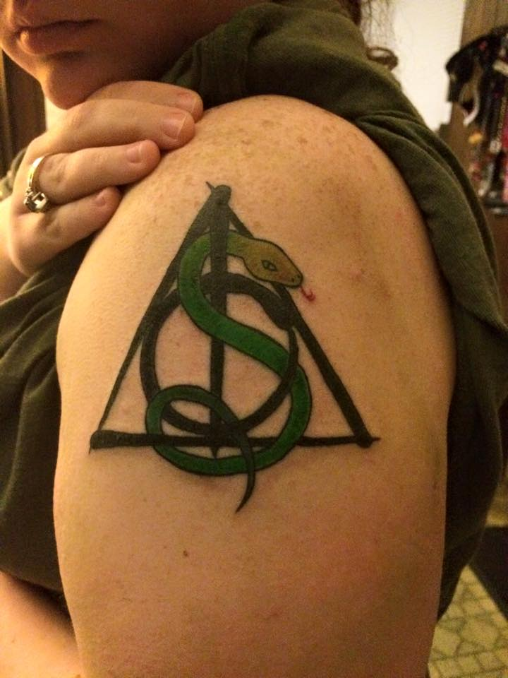 Snake With Nice Black Ink Deathly Hallows Tattoo On Bicep