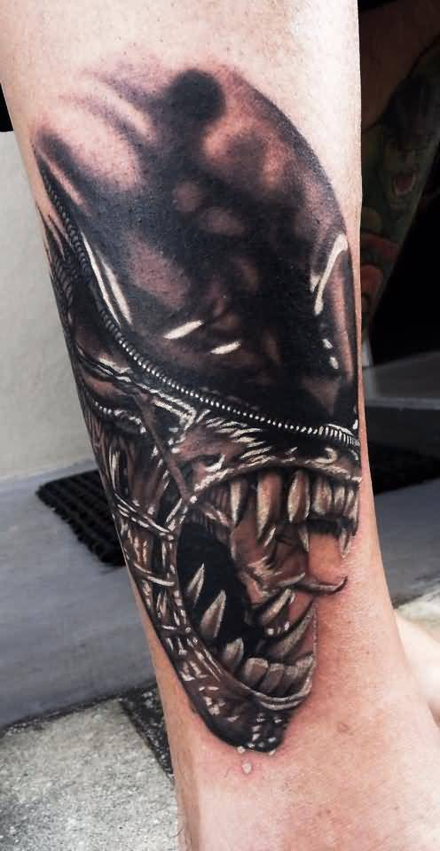Spooky Predator Face Tatttoo On Arm Design By Levi Barnett