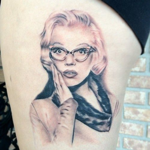 Surprise Marilyn Monroe Portrait Face Tattoo Design On Thigh