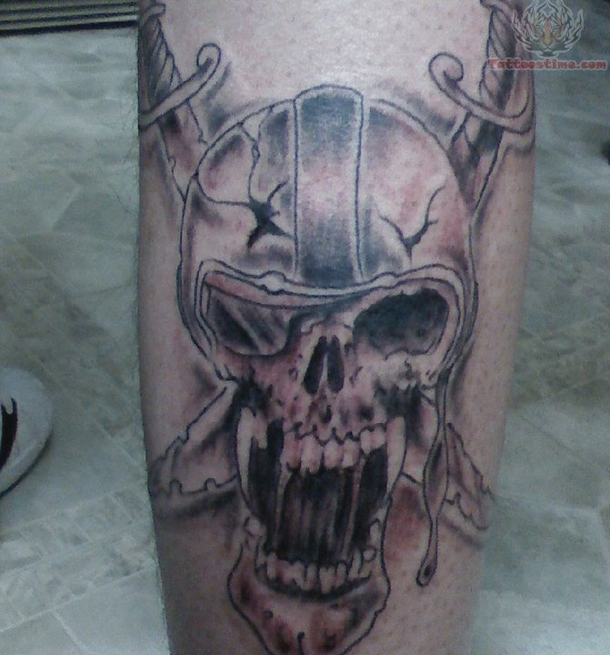 Sword Angry Skull Oakland Raiders Tattoo On Back Leg
