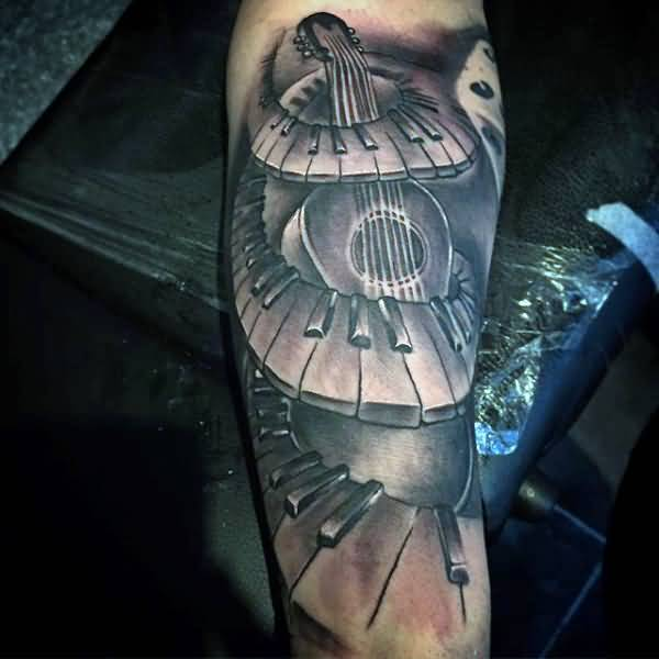 Ultimate And Nice Piano Keys Tattoo Design Idea With Guitar