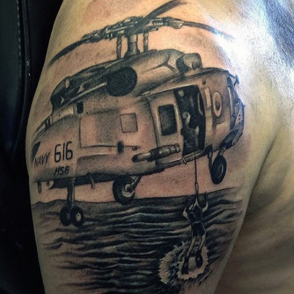 Ultimate Navy Helicoper With Men In Water Tattoo On Shoulder