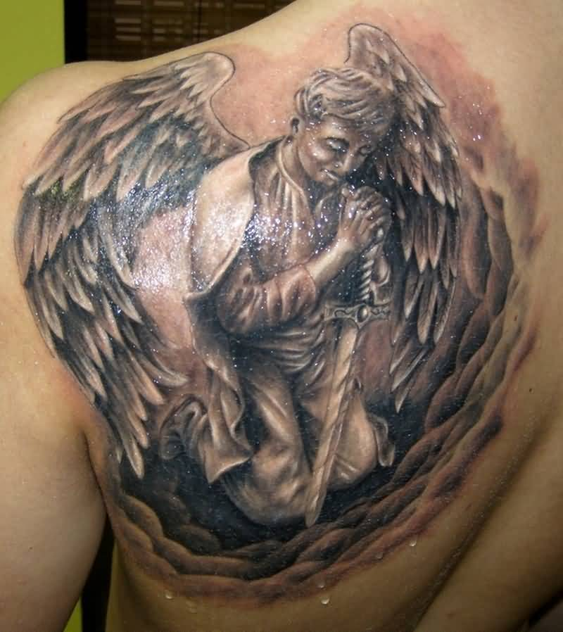 Upper Back Brilliant Praying Men In Angel Wings Tattoo