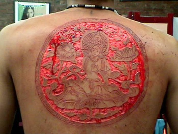 Upper Back Extreme Scarification Tattoo