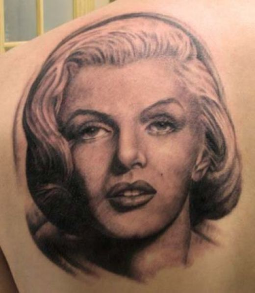 Upper Back Nice And Amazing Marilyn Monroe Tattoo Of Girl Face