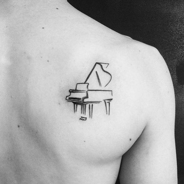 Upper Back Nice Clean And Neat Awesome Black Ink Grand Piano Tattoo